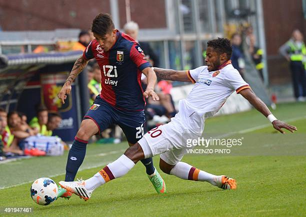 AS Roma's Brazilian midfielder Michel Fernandes Bastos takles Genoa's forward Adrian Ricardo Centurion of Argentina during the last football match of...