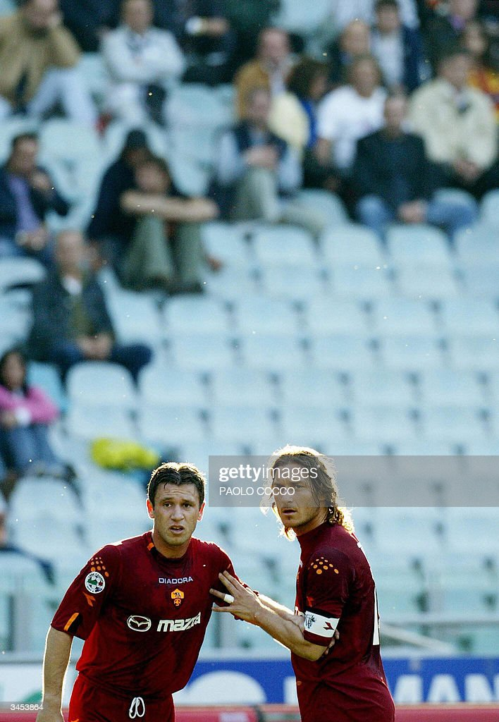 AS Roma's captain Francesco Totti (R) and forward Antonio Cassano wait for a free kick during Lazio vs AS Roma Serie A soccer match at Rome's Olympic stadium 21 April 2004.