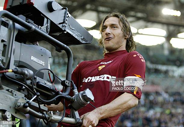 Roma's captain Francesco Totti celebrates with a tv camera after scoring against Lazio during their Serie A soccer match at Rome's Olympic stadium 21...