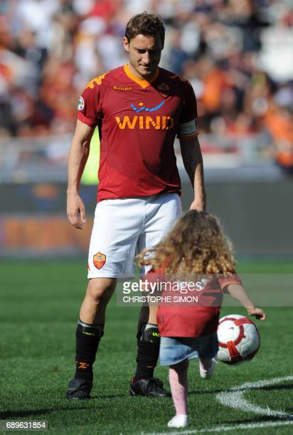 AS Roma's Captain Francesco Totti celebrates with daughter Chanel after his team's Italian Serie A football match against Cagliari on May 9 2010 at...