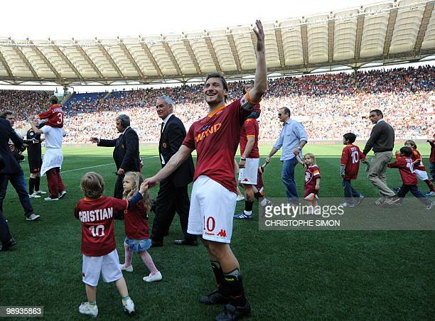 AS Roma's Captain Francesco Totti celebrates with his daughter Chanel and son Christian after his team's Italian Serie A football match against...