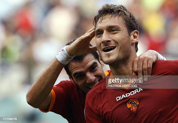 Roma's captain Francesco Totti celebrates wth teammate Simone Perrotta after scoring against Chievo Verona during their Italian serie A football...