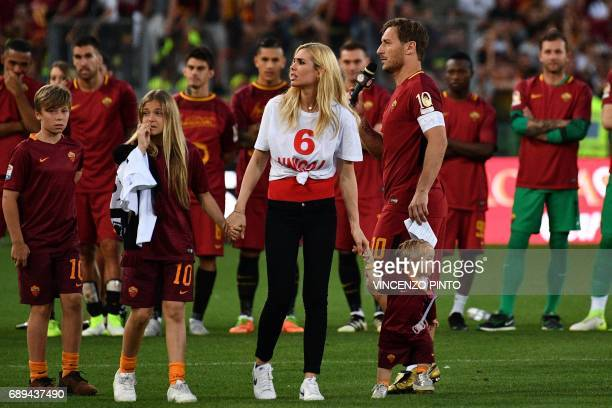 AS Roma's captain Francesco Totti delivers a speech next to his wife Ilary and his children Isabel Chanel and Cristian during a ceremony following...