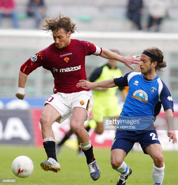 Roma's captain Francesco Totti vies with Empoli's defender Andrea Cupi during their Italian Serie A football match in Palermo's Renzo Barbera stadium...
