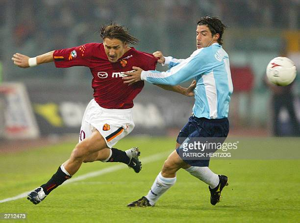Roma's captain Francesco Totti vies with Lazio's counterpart Giuliano Giannichedda 09 November 2003 in Rome's olympic stadium during the roman derby...