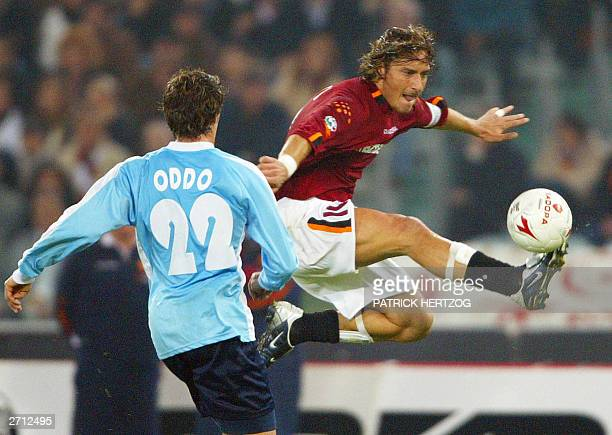 Roma's captain Francesco Totti vies with Lazio's defender Massimo Oddo 09 November 2003 in Rome's olympic stadium during the Roman derby match...