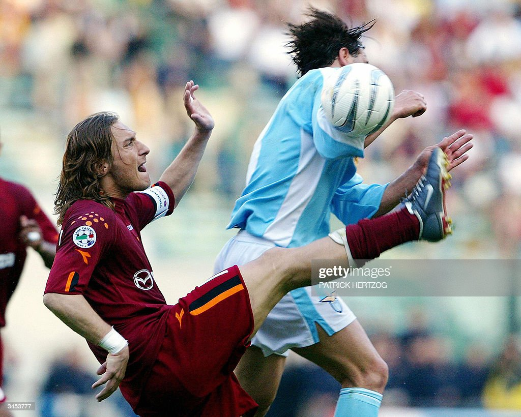 AS Roma's captain Francesco Totti (L) vies with Lazio's forward Roberto Muzzi, during their Italian Serie A football match in Rome's Olympic stadium, 21 April 2004. AFP PHOTO/ Patrick HERTZOG