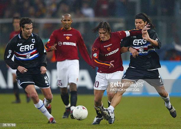 Roma's captain Francesco Totti vies with Sampdoria Genoa's midfielders Cristiano DONI and Stefano SACCHETTI as teammate French midfielder Olivier...