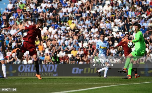 Roma's Czech forward Patrik Schick heads the ball and scores a goal past SPAL's Italian goalkeeper Alex Meretto during the Italian Serie A football...