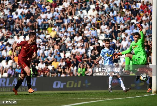 TOPSHOT Roma's Czech forward Patrik Schick heads the ball and scores a goal past SPAL's Italian goalkeeper Alex Meret to during the Italian Serie A...