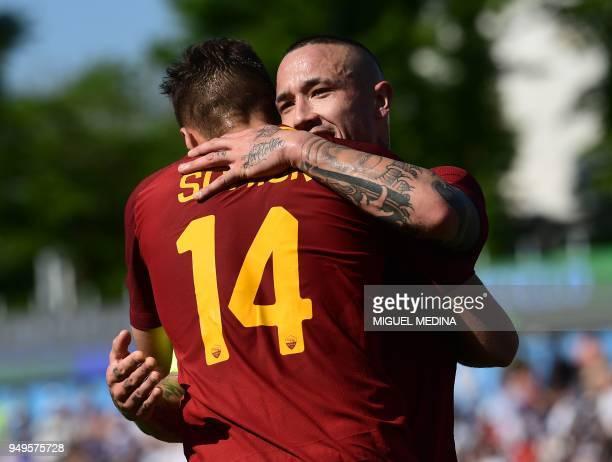 Roma's Czech forward Patrik Schick is congratulated by Roma's Belgian midfielder Radja Nainggolan after scoring a goal during the Italian Serie A...