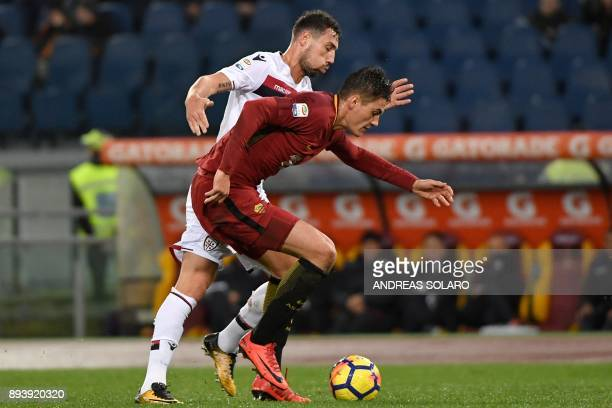 Roma's Czech striker Patrik Schick fights for the ball with Cagliari's midfielder from Moldova Artur Ionia during the Italian Serie A football match...