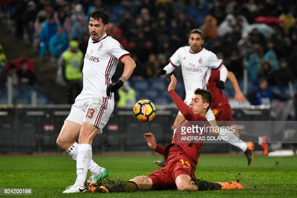 Roma's Czech striker Patrik Schick vies for the ball with AC Milan's Italian defender Alessio Romagnoli during the Italian Serie A football match...