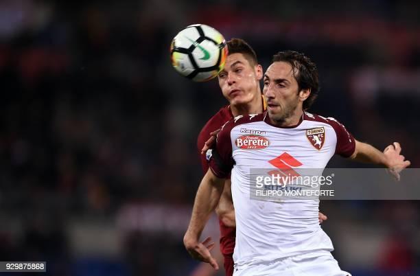 Roma's Czech striker Patrik Schick vies with Torino's Italian defender Emiliano Moretti during the Italian Serie A football match Roma versus Torino...