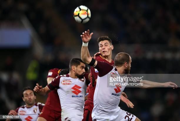 Roma's Czech striker Patrik Schick vies with Torino's Italian defender Lorenzo De Silvestri during the French Ligue 1 football match between...