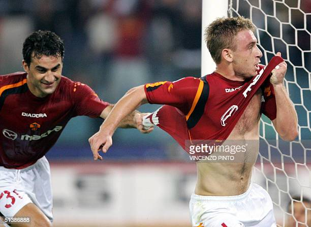 Roma's Daniele De Rossi celebrates with his teammate Traianos Dellas after scoring against Inter Milan during their Italian Serie A football match at...