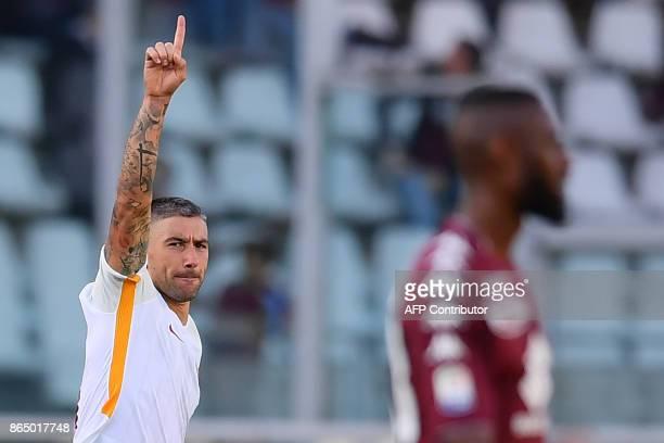 AS Roma's defender Aleksandar Kolarov from Serbia celebrates after scoring a goal during the Italian Serie A football match Torino Vs Roma on October...