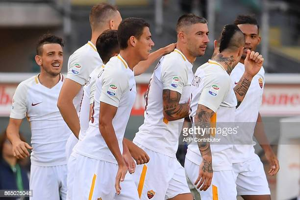 AS Roma's defender Aleksandar Kolarov from Serbia celebrates after scoring with his teammates during the Italian Serie A football match Torino Vs...