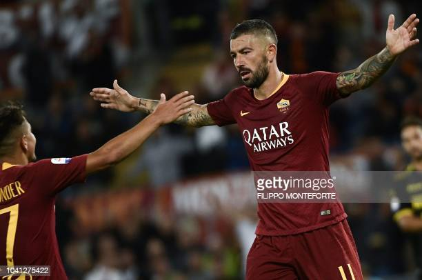 Roma's defender Aleksandar Kolarov from Serbia celebrates with teammate midfielder Cengiz Under from Turkey after scoring a goal during the Serie A...