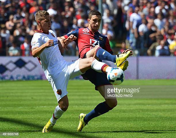 AS Roma's defender Brazilian Leandro Castan fights for the ball with Genoa's forward Adrian Ricardo Centurion of Argentina during the Italian Serie A...