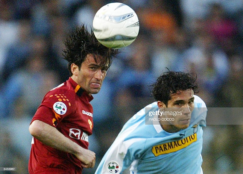 AS Roma's defender Christian Panucci (L) jumps for a ball with Lazio's forward Bernardo Corradi during their Serie A soccer match at Rome's Olympic stadium 21 April 2004. The match ended in a 1-1 draw.
