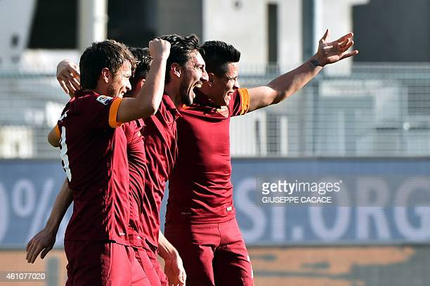 Roma's defender Davide Astori celebrates after scoring during the Serie A football match Udinese vs AS Roma at Stadio Friuli in Udine on January 6...