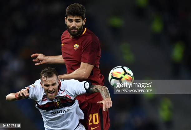 Roma's defender from Argentina Federico Fazio and Genoa's midfielder Luca Rigoni go for the ball during the italian Serie A football match Rome vs...