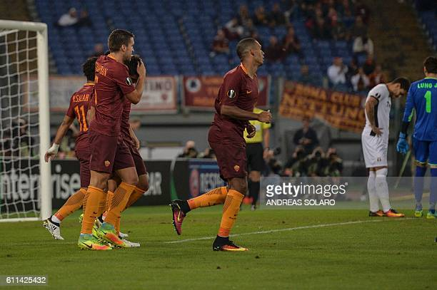 AS Roma's defender from Brazil Bruno Peres and AS Roma's midfielder from Netherlands Kevin Strootman celebrates after the own goal by Astra's...