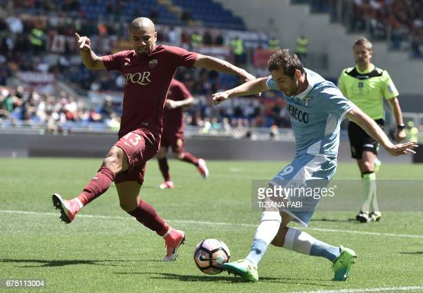 Roma's defender from Brazil Bruno Peres fights for the ball with Lazio's midfielder from BosniaHerzegovina Senad Lulic during the Italian Serie A...
