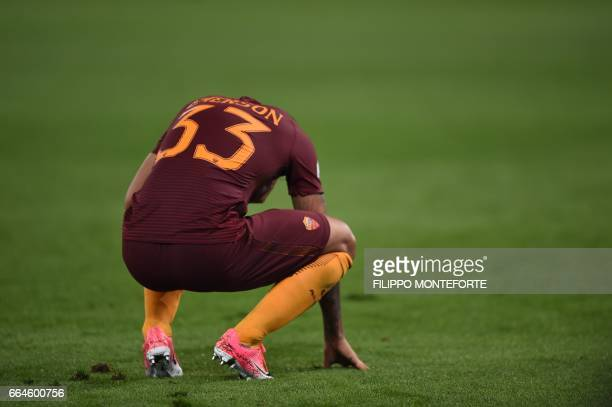 Roma's defender from Brazil Emerson Palmieri reacts during the Italian Tim Cup second leg semifinal football match AS Roma vs Lazio on April 4 2017...