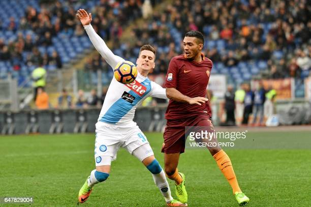 Roma's defender from Brazil Juan Jesus vies with Napoli's forward from Poland Arkadiusz Milik during the Italian Serie A football match AS Roma vs...