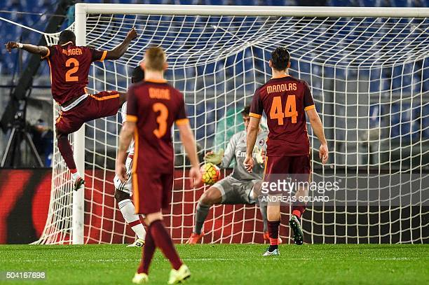 Roma's defender from Germany Antonio Rudiger kicks the ball and scores against AC Milan's goalkeeper from Italy Gianluigi Donnarumma during the...