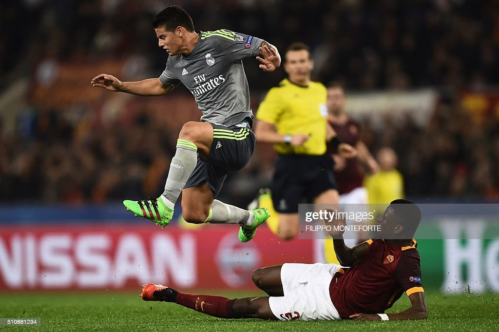 Roma's defender from Germany Antonio Rudiger (bottom) vies with Real Madrid's Colombian midfielder James Rodriguez during the UEFA Champions League football match AS Roma vs Real Madrid on Frebruary 17, 2016 at the Olympic stadium in Rome. Real Madrid won 0- 2.
