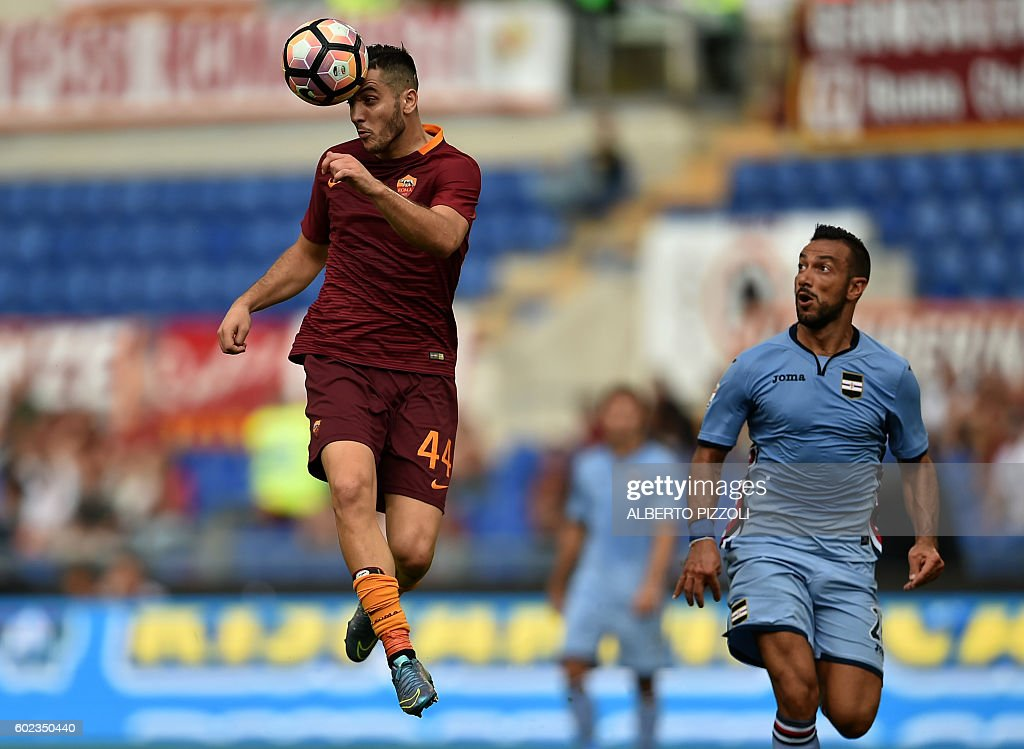Roma's defender from Greece Kostas Manolas (L) fights for the ball with Sampdoria's forward Fabio Quagliarella during the Italian Serie A football match between As Roma and Sampdoria on September 11, 2016 at Olympic stadium in Rome. / AFP / ALBERTO