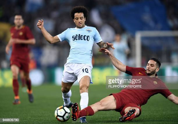 Roma's defender from Greece Kostas Manolas vies with Lazio's midfielder from Brazil Felipe Anderson during the Italian Serie A football match between...