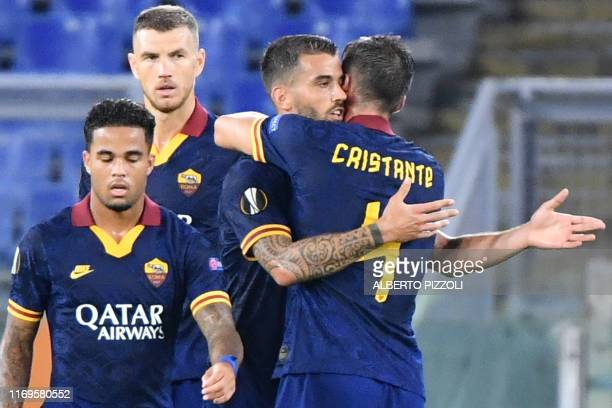 Roma's Dutch forward Justin Kluivert, AS Roma's Bosnian forward Edin Dzeko, AS Roma's Italian defender Leonardo Spinazzola and AS Roma's Italian...