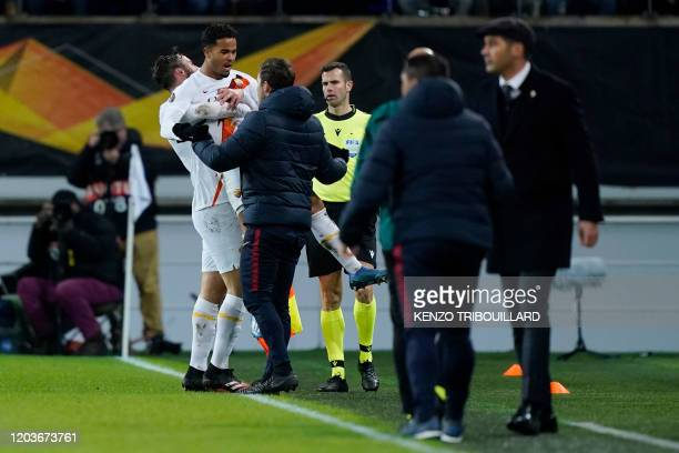 AS Roma's Dutch forward Justin Kluivert celebrates scoring his team's first goal during the UEFA Europa League round of 32 second leg football match...