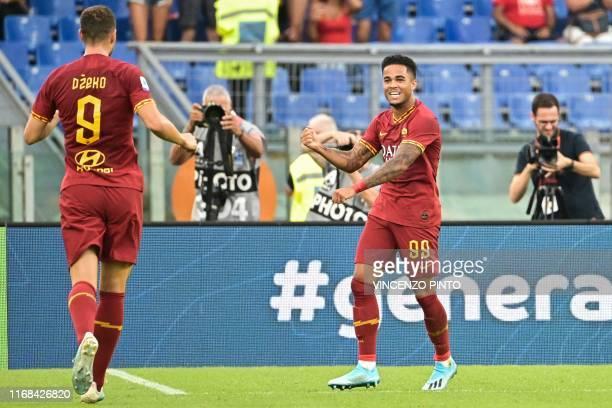 AS Roma's Dutch forward Justin Kluivert celebrates with AS Roma's Bosnian forward Edin Dzeko after scoring his team's fourth goal during the Italian...