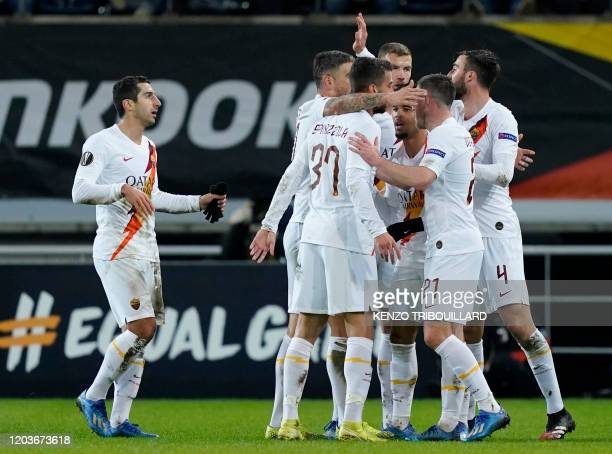 AS Roma's Dutch forward Justin Kluivert celebrates with his teammates after scoring his team's first goal during the UEFA Europa League round of 32...
