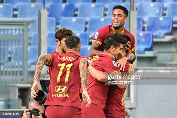 AS Roma's Dutch forward Justin Kluivert celebrates with teammates and AS Roma's Italian midfielder Bryan Cristante after Cristante opened the scoring...
