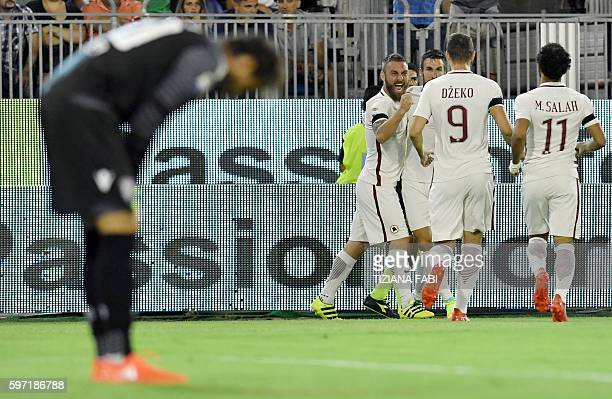 Roma's Dutch midfielder Kevin Strootman celebrates after scoring a goal during the Serie A football match between Cagliari and Roma at the Sant'Elia...