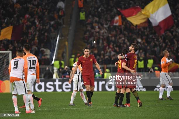 Roma's Dutch midfielder Kevin Strootman Roma's Italian midfielder Daniele De Rossi and Roma's Italian midfielder Alessandro Florenzi celebrate afer...