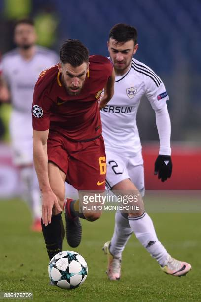 Roma's Dutch midfielder Kevin Strootman vies with Qarabag's Azerbaijani midfielder Gara Garayev during the UEFA Champions League Group C football...