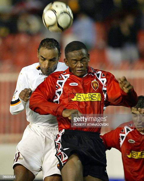 Roma's Emerson Fereira and Vardar's Anyanwy Chinedu jump to headoff the ball during their UEFA Cup match 15 October 2003 at Site Stadium in Skopje...