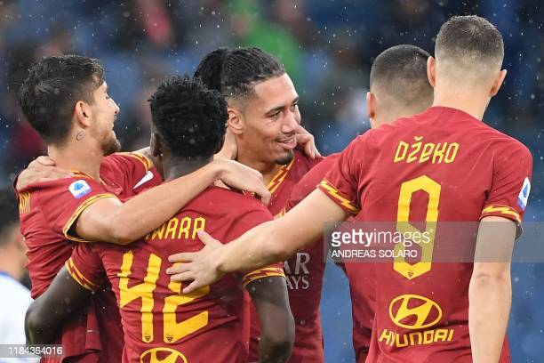 Roma's Englis defender Chris Smalling celebrates after opening the scoring during the Italian Serie A football match Roma vs Brescia on November 24...