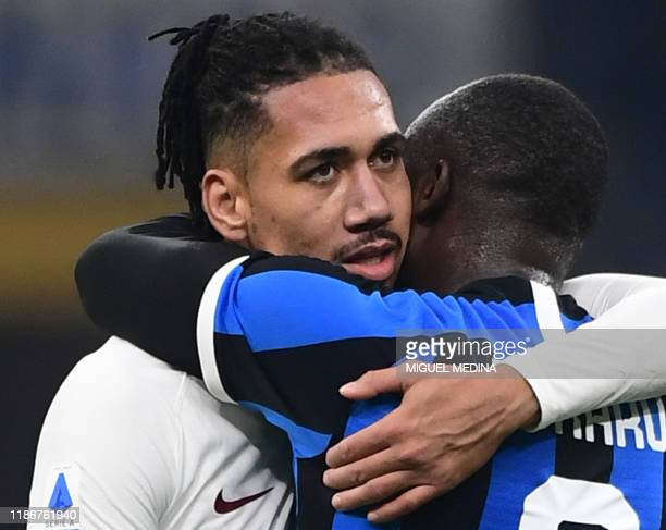 AS Roma's English defender Chris Smalling and Inter Milan's Belgian forward Romelu Lukaku embrace at the end of the Italian Serie A football match...