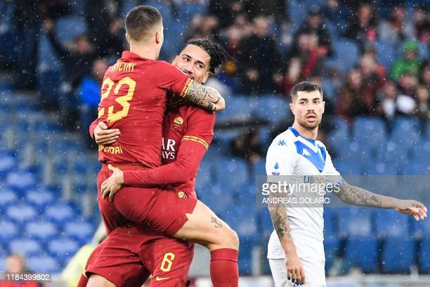 Roma's English defender Chris Smalling embraces AS Roma's Italian defender Gianluca Mancini after opening the scoring during the Italian Serie A...