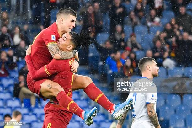 AS Roma's English defender Chris Smalling embraces AS Roma's Italian defender Gianluca Mancini after opening the scoring during the Italian Serie A...