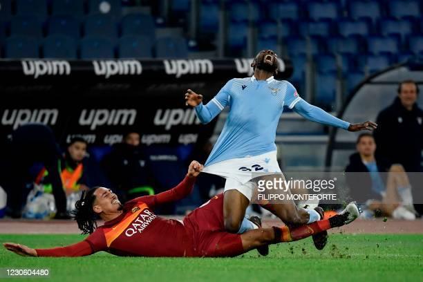 Roma's English defender Chris Smalling tackles Lazio's Ivorian midfielder Jean Daniel Akpa Akpro during the Italian Serie A football match Lazio Rome...