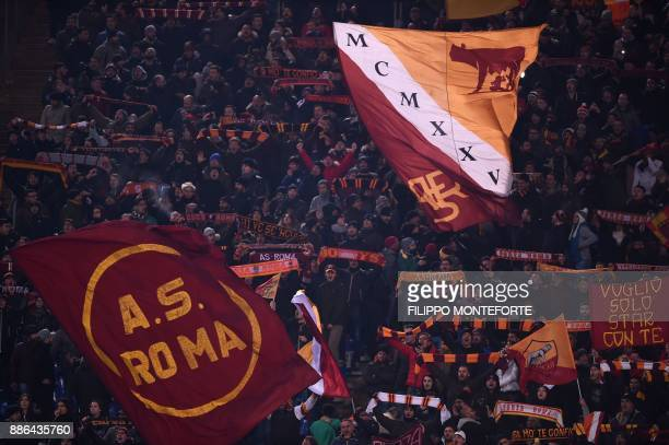 AS Roma's fans cheer during the UEFA Champions League Group C football match AS Roma vs FK Qarabag on December 5 2017 at the Olympic stadium in Rome...